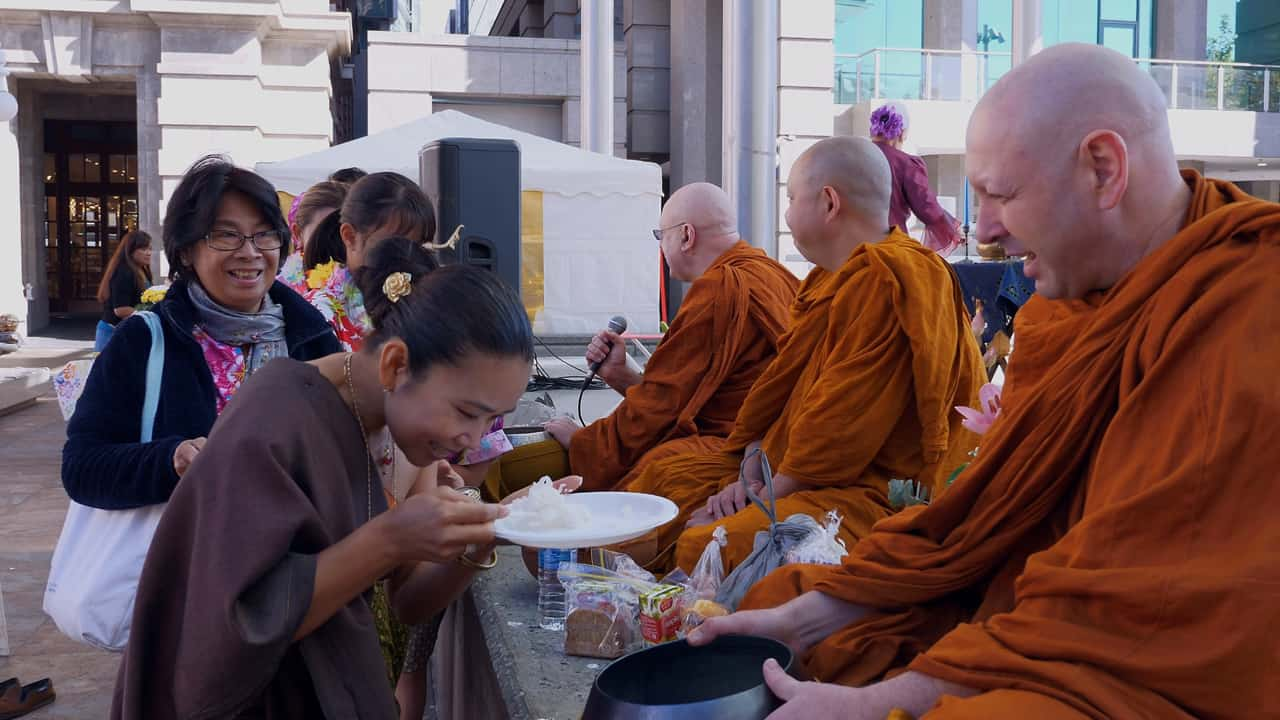 Blessing by Monks gift offering Songkran Festival Perth Australia