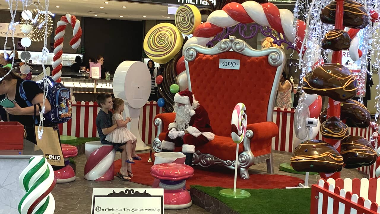 Santa Claus Its Christmas Time with overcrowded shopping centres